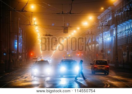 Man cross the Lenin Avenue At Night In Gomel, Belarus