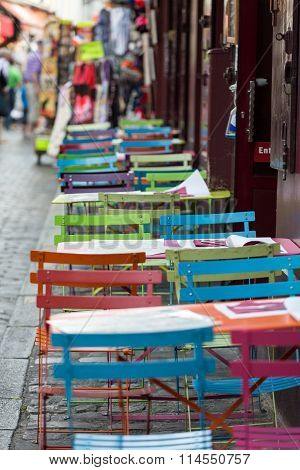 PARIS , FRANCE -SEPTEMBER 10,  2014: Paris - Very colorful Parisian outdoor cafe in Montmartre
