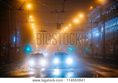 Night Traffic in fog On Lenin Avenue In Gomel, Belarus