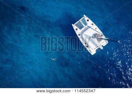 Catamaran in open sea - aerial / drone view