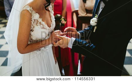 Putting the wedding ring on
