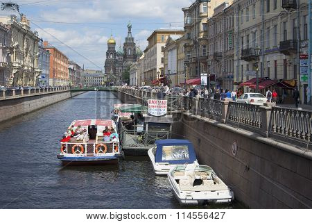 The pier of the excursion boats on the canal june day. St. Petersburg
