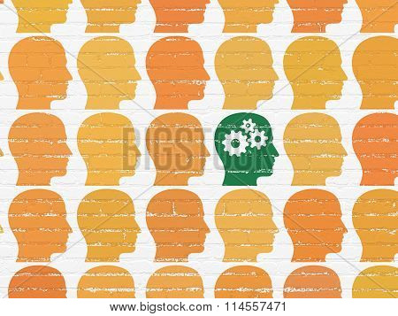 Business concept: head with gears icon on wall background