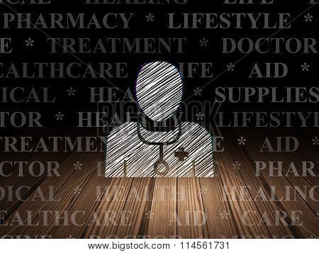 Healthcare concept: Doctor in grunge dark room