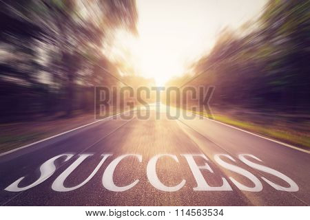 Empty Blur Asphalt Road And Sunlight And Sign Which Symbol Success. Concept For Success.