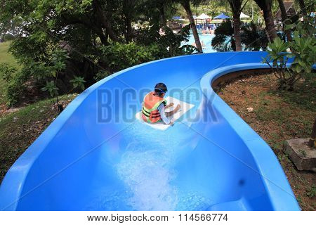 Japanese boy on the water slide (5 years old)