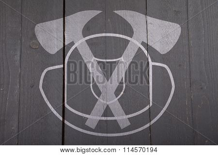 Illustration Of Fire Man Sign With Helmet And Axes On Dark Black Wooden Background