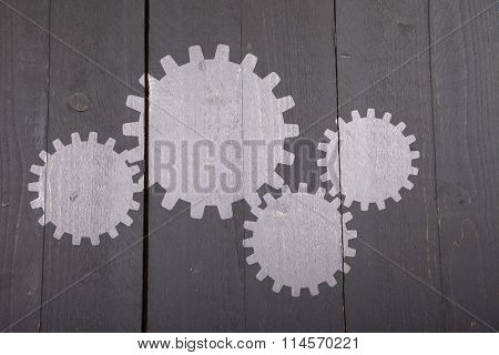 Illustration Of White Gears On Dark Black Wooden Background