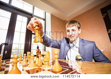 couple playing chess on wedding day