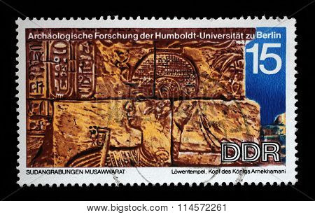 GDR - CIRCA 1970: Stamp printed in GDR. Sudanese Archaeological Excavations by Humboldt University Expedition, head of the King Arnekhamani, carvings unearthed at Lions Temple, Musawwarat, circa 1970
