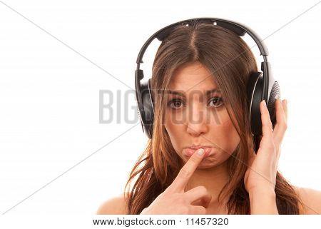 Young Girl Listening Music In Big Headphones