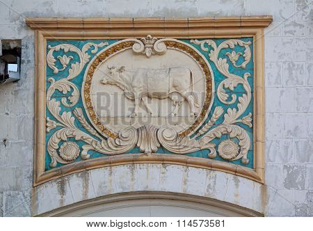Kiev, Ukraine - September 25, 2015: Bas-relief of the Soviet era in the building of the livestock pa