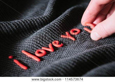On Valentines Day. Man wrote confession of love in red letters. Phrase I love you