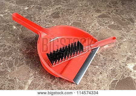 Brush and dustpan.