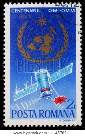 ROMANIA - CIRCA 1973: a stamp printed in Romania shows The 100th Anniversary of the World Meteorological Organization, circa 1973.