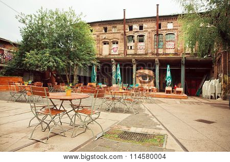 Empty Cafe In Abandoned Courtyard Of Artistic Area Of Berlin