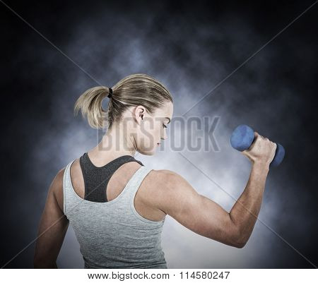 Muscular woman working out with dumbbells against dark background Muscular woman working out with dumbbells on white background
