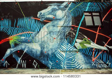 Wild Horse By Unknown Artist On Rustic Street Wall With Graffiti
