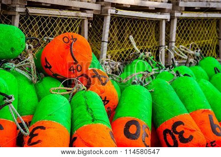 green and orange lobster buoys