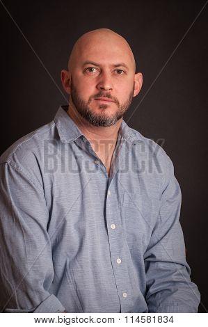 Studio Portrait Of Bold Man With Beard