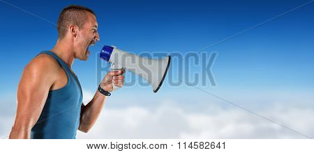 Angry male trainer yelling through megaphone against blue sky over clouds