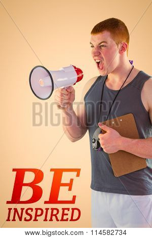 Angry personal trainer yelling through megaphone against orange background