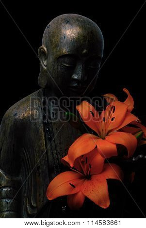 buddha face and profile with flower