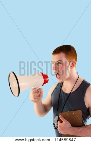 Angry personal trainer yelling through megaphone against blue background