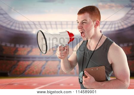 Angry personal trainer yelling through megaphone against race track