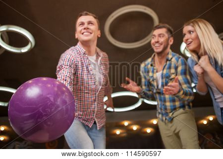 Attractive three friends are faking fun in kegling club