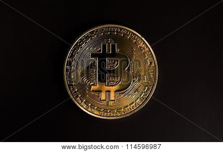 One Bitcoin On Black Backround