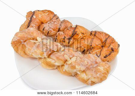 Closeup danish pastry twist on white dish