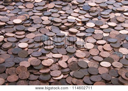 many old dirty pennies. bronze and copper pennies scattered on the table or floor