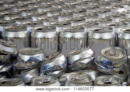 aluminum can recycling landscape close view crushed and uncrushed cans