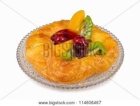 danish pastry with fruits crystal dish isolated