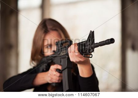 Woman with weapon aiming to target