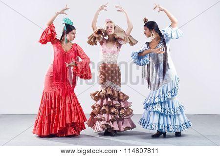 Pretty Three Young Flamenco Dancer In Beautiful Dress.