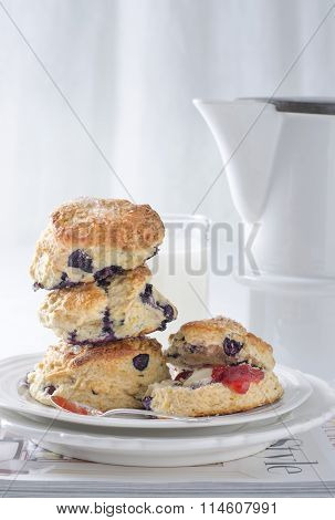 Stacked Scones With Jam Teapot And Milk