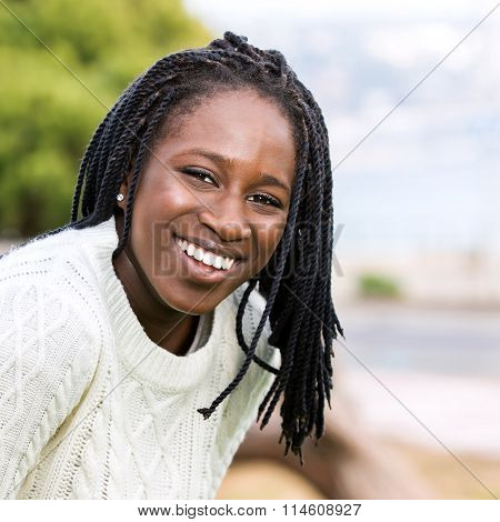 Cute African Teen Girl With Long Braided Hairstyle.