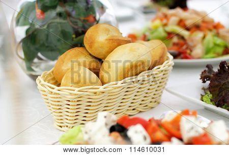 Buns in a wicker basket.