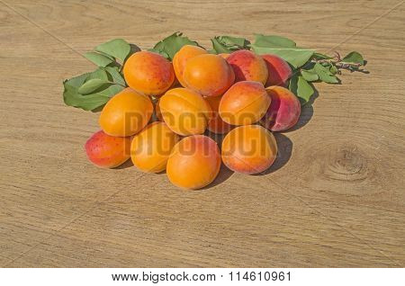 Fresh apricots on  wood