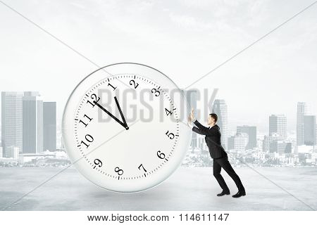 Businessman Trying To Stop Time Concept