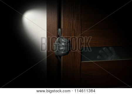 Mans Hand In A Black Glove Open The Door
