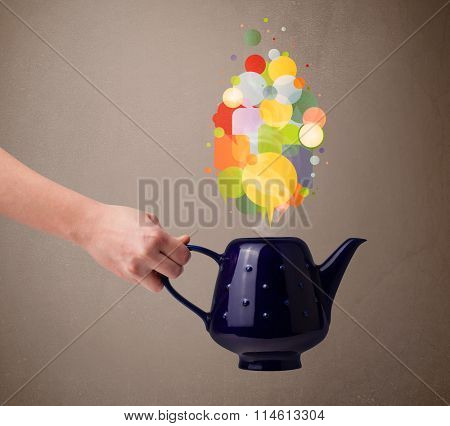 Coffee pot with colorful speech bubbles, close up