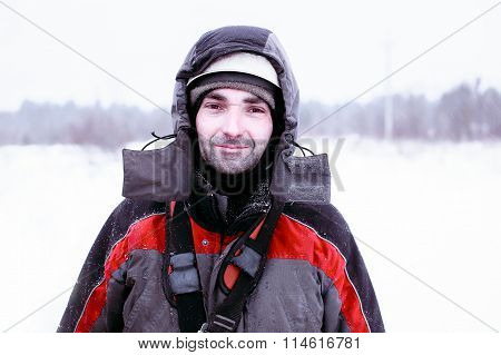 Worker in helmet and overalls outdoors in winter