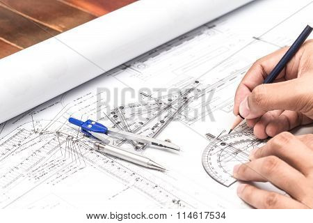 Close-up Of Architect Hands Working On A Blueprint In Office. Blueprints Were Created By Photographe