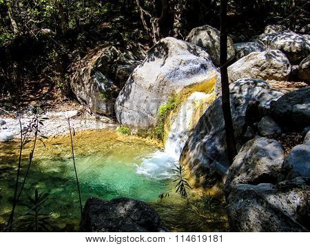 Pond and miniature waterfall in Samaria gorge