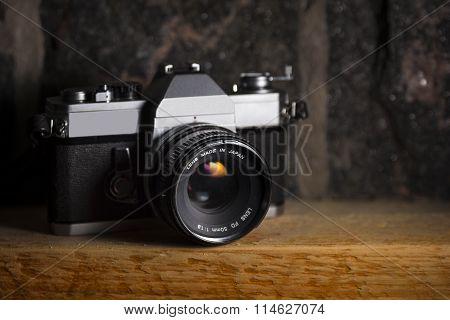 Vintage Camera on Wood & Stone Background