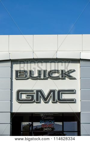 Buick Gmc Automobile Dealership Exterior And Logo.
