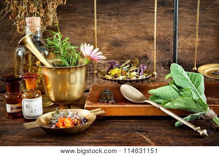 Ancient herbal medicine, vials and scale on wooden background